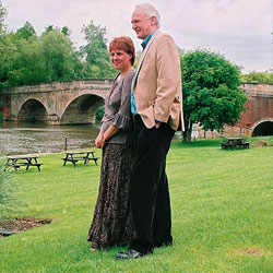 a couple relaxing at an open retirement course, Shillingford Bridge Hotel